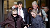 U.S. Secretary of State Hillary Clinton leaves New York Presbyterian Hospital with husband, Bill, and daughter, Chelsea,  in New York