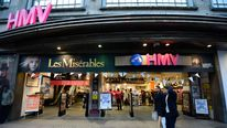 Shoppers pass an HMV shop in central London