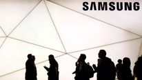 People walk past a Samsung stand at the Mobile World Congress in Barcelona