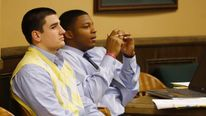 Trent Mays (L) and Ma'lik Richmond (R) sit in juvenile court during a recess in Steubenville, Ohio, March 14, 2013. The judge deciding the fate of two high school football players in Ohio accused of raping a drunk classmate last summer will hear more testimony on Thursday from prosecution witnesses - and more sharp questioning from defense attorneys - as the trial enters its second day. REUTERS/Keith Srakocic/Pool (UNITED STATES - Tags: CRIME LAW EDUCATION SPORT SOCIETY)