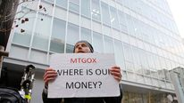 A man holds a placard to protest against Mt Gox in Tokyo