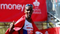 Mo Farah of Britain gestures after finishing in eighth position in the men's Elite London Marathon