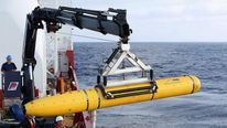Crew aboard the Australian Defence Vessel Ocean Shield move the U.S. Navy's Bluefin-21 autonomous underwater vehicle into position for deployment in the southern Indian Ocean.