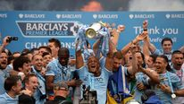 Manchester City's captain Vincent Kompany celebrates after winning the English Premier League trophy following their soccer match against West Ham United