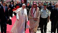 Pope Francis is welcomed by Jordan's Prince Ghazi bin Muhammad in Amman