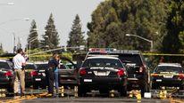 Investigators examine the scene of the conclusion of a police pursuit in Stockton, California