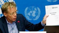 Assistant director-general of the WHO, Bruce Aylward, holds up the Ebola Response Roadmap report