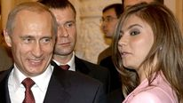 Russian President Vladimir smiles as looks at the Russian gymnast Kabayeva during the meeting with ...