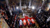 The coffins of Serbian King Petar and his wife Queen Aleksandra, mother Queen Maria and brother Prince Andrej lie inside the St. George's Church during their funeral in Topola