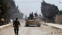 Forces of Syrian President Bashar al-Assad are seen in Arjoun village near Qusair town