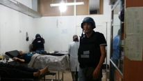 U.N. chemical weapons experts visit wounded people affected by an apparent gas attack, at a hospital in the southwestern Damascus suburb of Mouadamiya