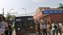 A police vehicle carrying four men accused of the gang rape of a 23-year-old woman on a bus on December 16 enters a court in Delhi