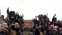 Gunmen gesture during fighting in Ramadi