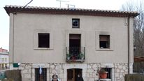 Spanish judicial police officers investigate the cause of a fire in a tourist country house, where six people were killed, in Tordomar