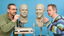 Madame Tussauds' studio artists Punter and Kempton work on clay head molds of presidential candidates in London