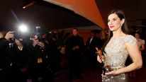 """Best actress winner Sandra Bullock from the film """"The Blind Side"""" poses with her Oscar in Hollywood"""