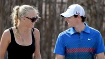 Caroline Wozniacki of Denmark and Rory McIlroy of Northern Ireland after the first round of the DP World Tour Championship