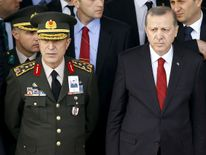 Turkey chief of staff General Hulusi Akar (left) with President Erdogan