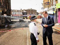 David Cameron with police after riots in Croydon