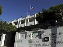 Graffiti against France is sprayed on a wall outside the French embassy in Tripoli, Libya, on August 30, 2011