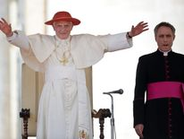 Pope Benedict XVI wearing a red Saturn h