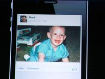 Facebook CEO Mark Zuckerberg shows a photo of himself as a baby