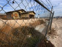 Abandoned houses at the Desert Mesa subdivision are pictured in north Las Vegas