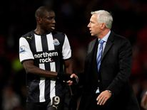 Alan Pardew and Demba Ba