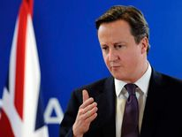 Britain Prime Minister David Cameron giv