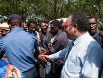 Peter O'Neill protest (R) greets supporters in the capital Port Moresby