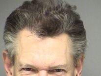 Randy Travis booking photo Feb 2012