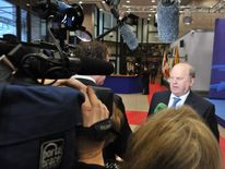 Irish Finance minister Michael Noonan speaks to journalists upon arrival at the Eurozone meeting on March 12, 2012 at the EU headquarters in Brussels.