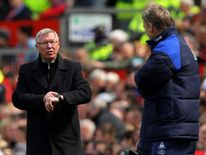 Sir Alex Ferguson and David Moyes on the touchline at Old Trafford in 2012