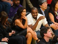 Kim Kardashian and Kanye West at a basketball match
