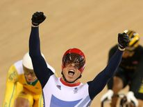 Sir Chris Hoy of Great Britain celebrates winning the Gold medal in the Men's Keirin Track Cycling Final
