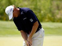 Ernie Els putts using a belly putter golf club