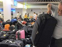 Passenger picking up luggage