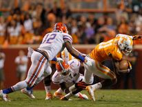 Antonio Morrison (No 12) making a tackle against Tennessee