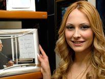 Noemi Letizia with a portrait of Silvio Berlusconi