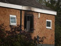 Fire damage shows on the 1st floor of a house in which four people have died on October 15, 2012 in Harlow, England.