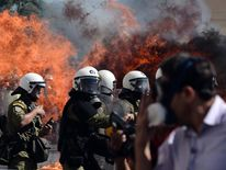 A fireboomb explodes near riot police during clashes with demonstrators.