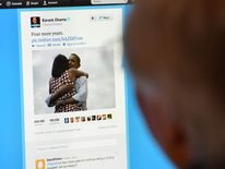 A man reads Barack Obama's tweet