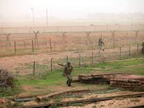 Turkish soldiers guard the border with Syria