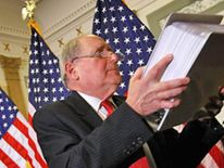 Senator Carl Levin holds evidence papers ahead of hearing into role of investment banks in financial crisis