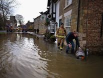 Residents Deal With Flooding Aftermath
