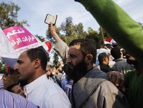A supporter of Islamist Egyptian President Mohamed Morsi holds up a copy of the Koran