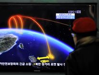 A TV viewer in South Korea watches a report on the trajectory of a North Korean rocket.