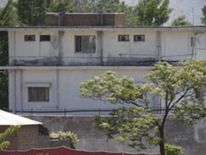 Soldiers keep guard around the compound within which al Qaeda leader Osama bin Laden was killed in Abbottabad