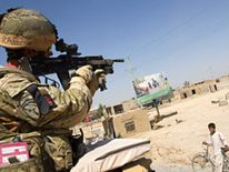 UK serviceman on patrol in Lashkar Gah, Helmand province, Afghanistan