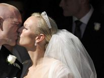 England rugby captain Mike Tindall and Zara Phillips after their marriage at Canongate Kirk in Edinburgh, Scotland.